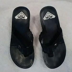 00a46c735327f Roxy Black Wedge Flip Flops Sz 7